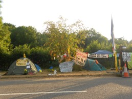 Tents and banners cover the road side.